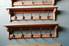 A selection of hall shelves with coat hooks