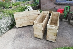 Three large planters on casters