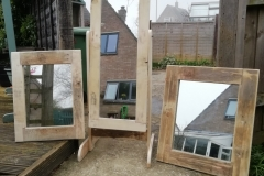 a trio of pallet wood mirrors