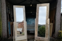 A pair of pallet wwood stand up mirrors