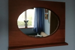 Oval mirror in mahogany frame