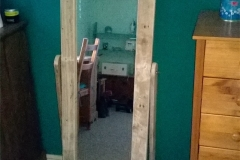 Upright mirror framed in pallet wood