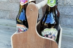4 bottle beer caddy made from reclaimed plywood and a curtain rod as a handle